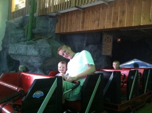 Timmy loved the roller coaster at Miner Mike's.